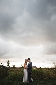 These gray clouds didn't stop Max and Sam Photography from taking this gorgeous couple portrait