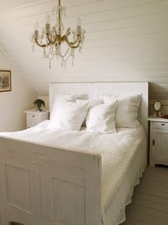 The winner of Norway´s Most Beautiful House-contest 2010. Beautiful bed, with old doors as head and foot board.
