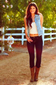 I love the jean vest and cowgirl boots. This outfits is such a perfect combo.