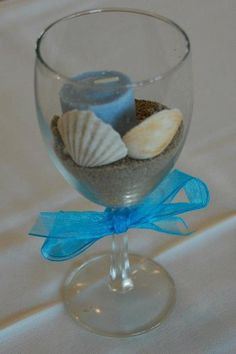 Sand, shells, and wine glass centerpiece