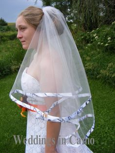 WEDDINGS IN CAMO.com This veil is circular tulle and is trimmed with CAMO ribbon, printed on both sides. Shown as the Waist length version, which displays the beauty of this veil. Veil Lengths:(listed