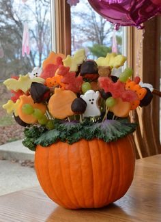 Halloween Fruit Arrangement - because I have soooo much time on my hands around Halloween.  But, this would be awesome for a class party.