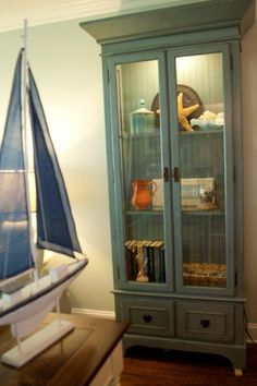 Week 6: Curio Cabinet. This is a type of cabinet used to hold almost anything. For example, it is can be used to display collections, pictures, trophies or medals, and beyond. It is smaller than a china cabinet and is a nice way to display things that are special to you.