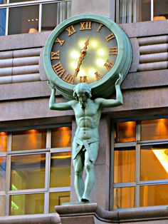 Atlas Clock on the facade of Tiffany & Co., 727 Fifth Avenue, New York City. The figure of Atlas shouldering the large clock was sculpted circa 1853 by Henry Frederick Metzler out of wood and painted to appear bronze with verdigris patina. Unusual Clocks, Cool Clocks, Plywood Furniture, Outdoor Clock, Sundial, Old Signs, Antique Clocks, Large Clock, Street Lamp