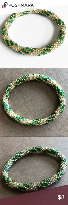 Lily & Laura Roll On Nepal Bracelet Green and Gold Lily & Laura Roll On Nepal Bracelet Green and Gold. These bracelets are a fair trade product made by women in Nepal to help sustain their families. They fit virtually every wrist simply by rolling on. Because of how they are crocheted they expand & retract by rolling, & will not break unless cut. As each are handmade, they may vary slightly in size. Each one is unique. They are stack-able & mix-and-matchable. Please check out my closet for…