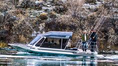 Idaho- A small boat carrying Bert, Sara and Angela speeds down the Snake River after a day of catch-and-release sturgeon fishing.