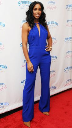 Kelly Rowland in a cobalt blue jumpsuit