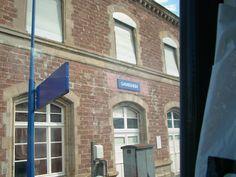 Bahnhofschild von Gambsheim am 25.07.2009.