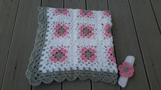 Whether youre cradling your own little one or looking for the perfect shower gift, this soft baby lacy granny square afghan is a must for the new little one in your life! This afghan is available in either approximately 28 X 32 or 32 X 32 (Your choice at check out!!). It was crocheted using pink, grey and white acrylic yarn. It is easily cared for: machine wash (cool water, gentle/delicate cycle) and machine dry (low temperature).  ***** PLEASE NOTE: My fuzzy friend is a working photo prop…