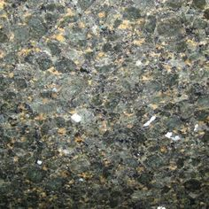 LABRADOR GOLD. Chunks of deep dark green with a blue hue and flecks of gold. Exquisite granite color available at Knoxville's Stone Interiors. Showroom located at 3900 Middlebrook Pike, Knoxville, TN. www.knoxstoneinteriors.com. FREE Estimates available, call 865-971-5800.