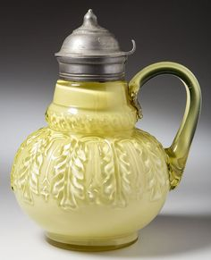 "NORTHWOOD NO. 263 / LEAF UMBRELLA SYRUP PITCHER, Topaz/cased lemon glossy (uranium), lemon applied handle with pressed-feather design to upper terminal, period lid with patent information. Northwood Glass Co. Pattern introduced 1889. 6 1/4"" HOA."