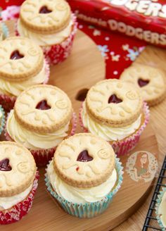Delicious, jammy, vanilla Jammie Dodger cupcakes, topped with a luscious vanilla buttercream frosting, and a Jammie Dodger of course!
