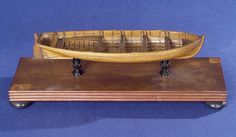Cutter(1838); Service vessel; Ship's boat - 	Scale: 1:24. A contemporary full hull model of a ship's cutter (circa 1838), built plank on frame in clinker construction in the Georgian style. Model is complete with four thwarts, bottom boards and seating in the stern, and a rudder (tiller missing)