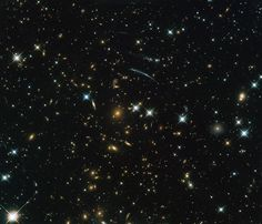 This image from the NASA/ESA Hubble Space Telescope shows the galaxy cluster PLCK G004.5-19.5.