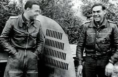 Heinz Bär stands next to his aircraft's tail, displaying his 60 victories around mid-august, 1941. With him on the right is his wingman Heinrich Hoffmann.