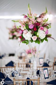 Very Elegant tall pink and lavender centerpiece in trumpet vase. Can be mixed with other lower centerpieces on other tables to create drama. Charlotte Geary Photography