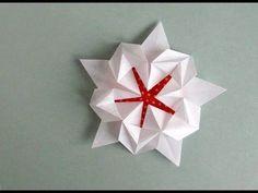 Origami Sakura Star -Estrella Pentagonal | Instructions: http://www.origamispirit.com/2012/11/how-to-make-a-pentagonal-origami-star/