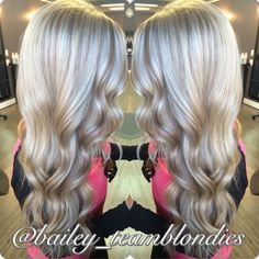 Beautiful platinum blonde with warm beige lowlights, curled with flat iron for a lovely wave! Call for appointment or free consultation 864-226-3030 or 864-934-3300