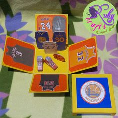 BASKETBALL-THEMED JERSEY EXPLOSION BOX Originally designed and sold by Ruby Crafts and Gifts Shop #rubycrafts #rubycraftsandgiftsshop #giftshop #jerseyexplotionbox #basketballthemedexplotionbox #personalizedexplotoinbox #explotionbox #explodingbox #favorideas #giftideas #personalizedgift #token #souvenir Exploding Boxes, Explosion Box, Favors, Basketball, Shop, Gifts, Things To Sell, Design, Souvenir
