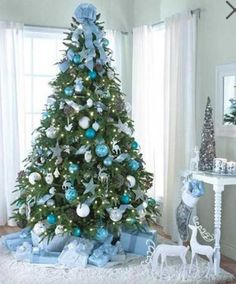 but if you truly want to stand out wed suggest you go for a blue christmas tree this year weve gathered a list of blue christmas tree decoration ideas - Aqua Christmas Decorations