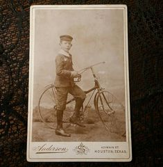 Antique Very unique identified young boy with His bicycle