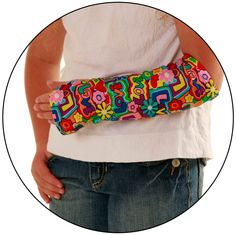 """Armz! fashion cast covers are perfect for both long and short arm casts, ideal for preventing snagging and scratching, while keeping your cast clean. Shown here in """"Groovy Love""""."""
