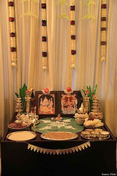 puja room with curtains and thali and idols