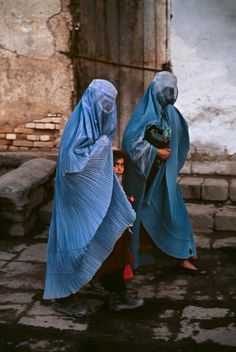 Rasheed gives Mariam a sky blue burqa which covers the whole body and falls over the knees and is used to keep a woman covered in afghan. They are compelled to wear it whenever they leave their home. (pg.70)