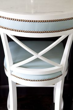 Bar Stool. Counter Stool. Kitchen counterstool ideas.  White x-back island counter stools upholstered in baby blu leather with nailhead trim. Anne Hepfer Designs.