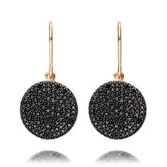 The Icon drop earrings feature black diamond pavé discs set in a delicate hue of 14 carat rose gold.