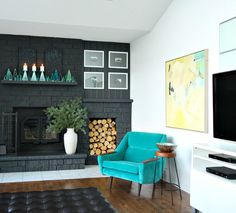 Grey Painted Brick Fireplace // Aqua MCM Velvet Chair // Colorful Abstract Art