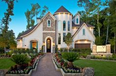 Immaculate landscaping adds major curb appeal to this custom home