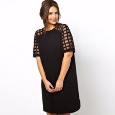 """Here's a twist on the """"Little Black Dress"""" with the shoulders and sleeves stitched on a see-through mesh with lattice work of the fabric. It's these the stunning design that makes this dress special! material: cotton, mesh"""