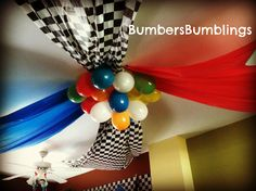 ceiling for Cars party, store tablecloths and balloons. Masking tape worked the best to make everything stick.