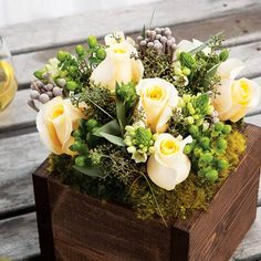 Subdued botanical beauty in a palette of textural whites and verdant greens. A bouquet of crème colored roses, Star of Bethlehem, hypericum berries, silver cape baubles and seeded eucalyptus comes expertly arranged in a dark stained hand crafted wood box. Adeline measures 7 x 7 x 9 and requires next day shipping.