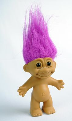 """Not just a memory.  My brother had one when we were young.  When I grew up I decided to get my own vintage Troll Doll.  Mine is approx. 9"""" tall and has lilac coloured hair.  I also have a collection of trolls that come out at Christmas time-- the twelve trolls of Christmas I call them."""