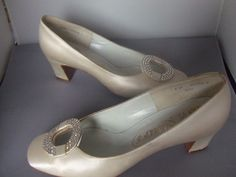 Rayne cream satin shoes with rhinestone buckle. 1960