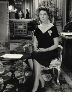 The Queen delivers her 1960 Christmas Broadcast from Buckingham Palace. The Christmas Broadcast dates back to 1932, when King George V spoke on the 'wireless' to the Empire from a small office at Sandringham. The time of the broadcast was 3.00pm, chosen by The British Monarchy, as the best time for reaching most of the countries in the Empire by short waves from the transmitters in Britain.