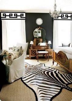 Black and White room, zebra hide rug, sisal, white slipcovered chair, ribbon trim valance DIY fabric valance