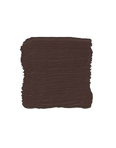 """Tudor Brown BENJAMIN MOORE TUDOR BROWN EXT. RM: """"I use a lot of brown because everything goes with it. This is like melted chocolate — sensuous, smooth, velvety. I don't think of it as dark, but rich. It anchors a room and gives you a luxurious feeling. I've used it lots in libraries, with white trim. All the beige, camel, and parchment colors look handsome with it."""" -Dan Carithers"""