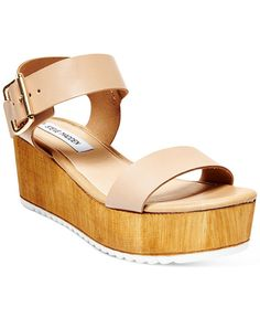 The boho vibe of Steve Madden's Nylee sandals pairs with faux wood flatform styling for a modern look with retro appeal. | Leather upper; manmade sole | Imported | Round open-toe ankle-strap platform