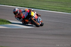 Somehow Casey Stoner manages to look relaxed while thrashing the Honda around the track. Photo by Scott Jones.