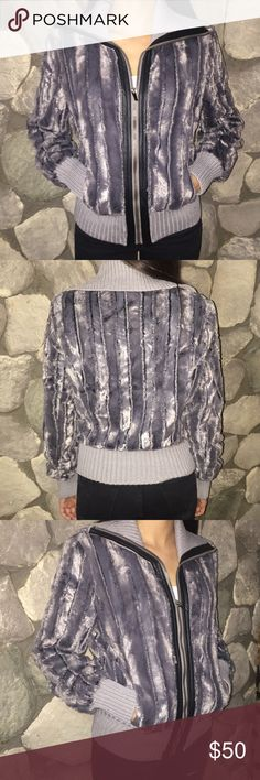 Gray faux fur jacket Make a statement with this beautiful gray faux fur jacket. Available Small medium Large.Xlarge Jackets & Coats