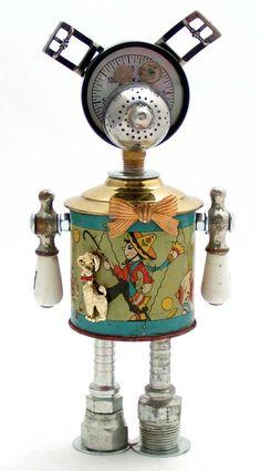 """Bonzo""   Height: 10.5""   Principal Components: Pressure gauge, coin bank, tea ball, buckles, faucet handles, hose fittings, pin"