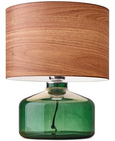 Modern with a retro vibe, this striking table lamp lends a unique pop of color…