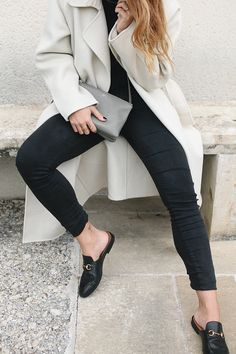 Outfit: The Cream Colored Wrap Coat. Desi is wearing a Sandro coat, Céline Trio bag, Gucci slippers and a all black look.