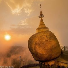 Photo by @irablockphoto (Ira Block) A fog settles in as the sun sets on Golden Rock and the Kyaiktiyo Pagoda at the top of Mt. Kyaiktiyo. Golden Rock is the third most important Buddhist pilgrimage site in Myanmar. The Pagoda sits atop a boulder that has been covered with gold leaves by devotees and looks as though it is ready to roll down hill off its perch. @natgeocreative #myanmar #burma #kyaiktiyo #pagoda #goldenrock #buddhism #monstate #goldleaf by thephotosociety