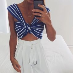 nautical stripes and knots paired with white wide leg pants