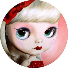 Blythe with sharp eyeliner and gorgeous red lips