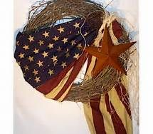 Primitive American flag wrapped wreath. I made one of these for my back door. It was easy to do and looks great.
